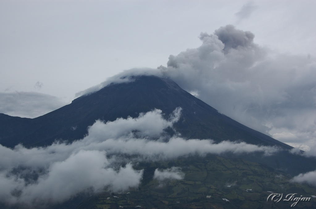 Tungurahua with its smoke and the low-lying clouds